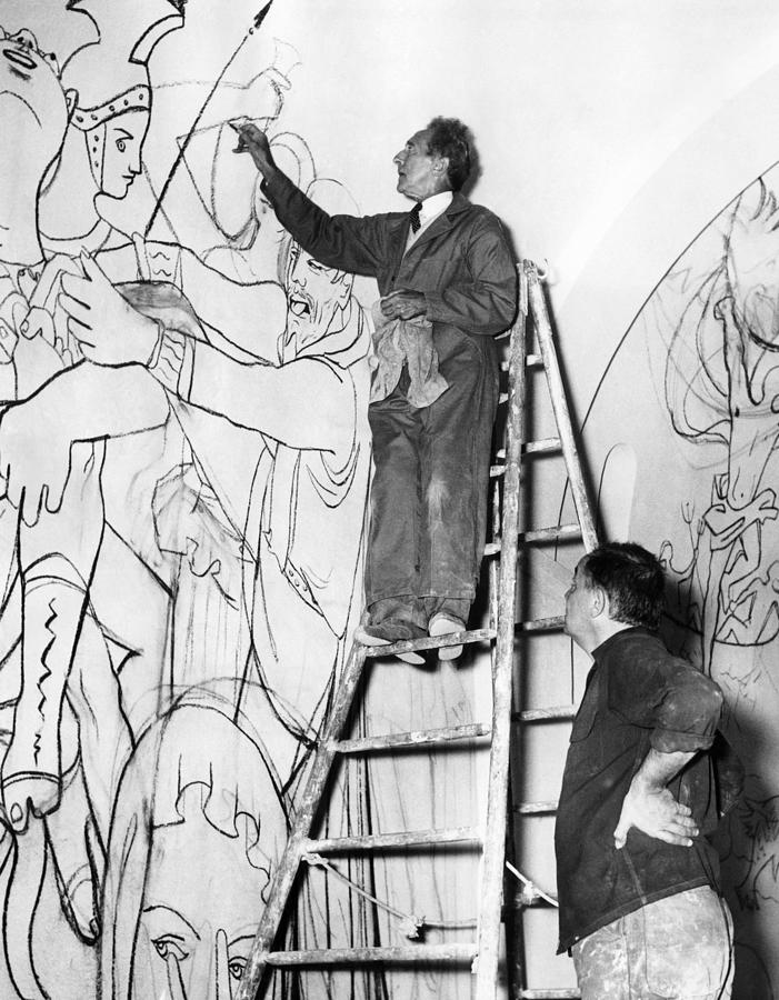 jean-cocteau-works-on-the-mural-everett